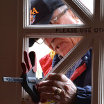 Bill repairs the front door of the church